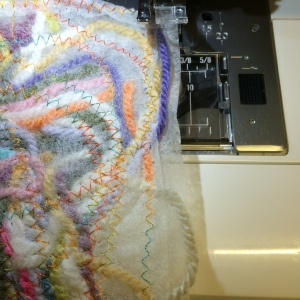 4 Continue stitching all over - up, down, right, left, in circles......