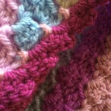 Round 2 - 3 chain, 2 tr crochet - sl st into next block.